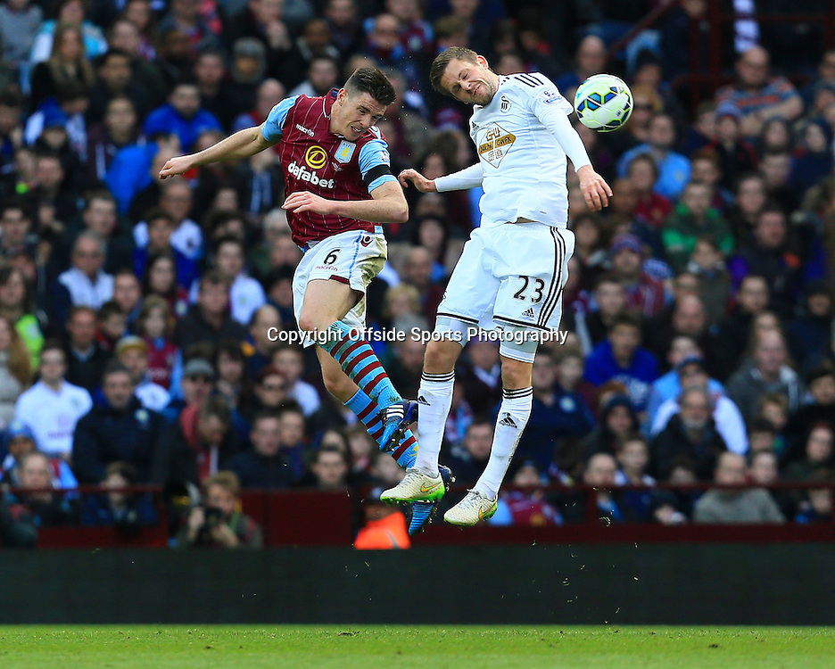 21st March 2015 - Barclays Premier League - Aston Villa v Swansea City - Ciaran Clarke of Aston Villa wins a header from Gylfi Sigurdsson of Swansea City - Photo: Paul Roberts / Offside.