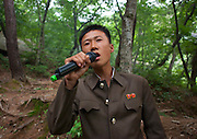 Sunday in North Korea<br /> <br /> What can you do on sunday when you live in a dictatorship? You can hardly fly outside of the for a week end, or take your car to the beach...<br /> So this is the time to enjoy simple activities for the north koreans and the best opportunity for foreigners to meet them as everyone is more relax, including your minders!<br /> <br /> Photo shows:   Karaoke is popular in North Korea and on sunday, with a mobile quipement, people like to sing patriotic and melancholic songs. This is the only time you&rsquo;ll be able to see people really relaxed.<br /> &copy;Eric Lafforgue/Exclusivepix Media