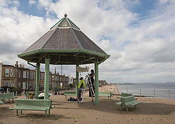 Across Portobello, Edinburgh artists are getting ready for this weekend's Art Walk Porty. A mixture of open studios, pop-up exhibition spaces, artists market and site-specitic art all over the Edinburgh suburb this weekend. The official launch takes place tonight (Thursday) but the event runs from Fri-Sun Sept 2nd-4th. 2016. Pictured: Juliana Capes installs her work at the Joppa Bandstand.<br /> <br /> <br /> © Jon Davey/ EEm