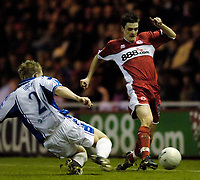 Photo: Jed Wee.<br /> Middlesbrough v Nuneaton Borough. The FA Cup. 17/01/2006.<br /> <br /> Middlesbrough's Adam Johnson (R) is tackled by Nuneaton's Robert Oddy.