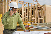 Construction worker using mobile phone