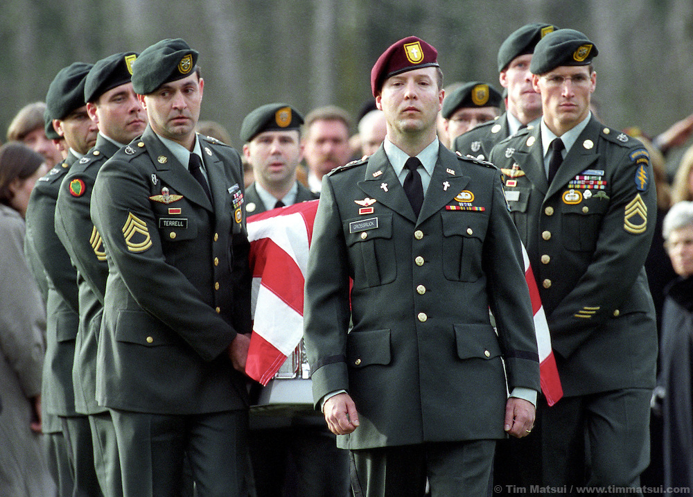 Fellow Green Berets serve as the honor guard for the burial of Sgt. 1st. Class Nathan Chapman at the Tahoma National Cemetery in Kent, Washington, on Friday, January 1, 2002. Chapman was the first U.S. soldier to be killed by hostile fire in Afghanistan since ground troops were committed. He died on January 4, 2002..