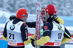 30.12.2011, DKB-Ski-ARENA, Oberhof, GER, Viessmann FIS Tour de Ski 2011, Pursuit/ Verfolgung Herren im Bild Tobias Angerer und Jens Filbrich gratulieren Axel Teichmann (alle GER) im Ziel zum Sieg . // during of Viessmann FIS Tour de Ski 2011, in Oberhof, GERMANY, 2011/12/30 .. EXPA Pictures © 2011, PhotoCredit: EXPA/ nph/ Hessland..***** ATTENTION - OUT OF GER, CRO *****