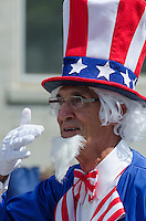 BAR HARBOR, MAINE, July 4, 2014. A man costumed as Uncle Sam marches in the Independence Day Parade