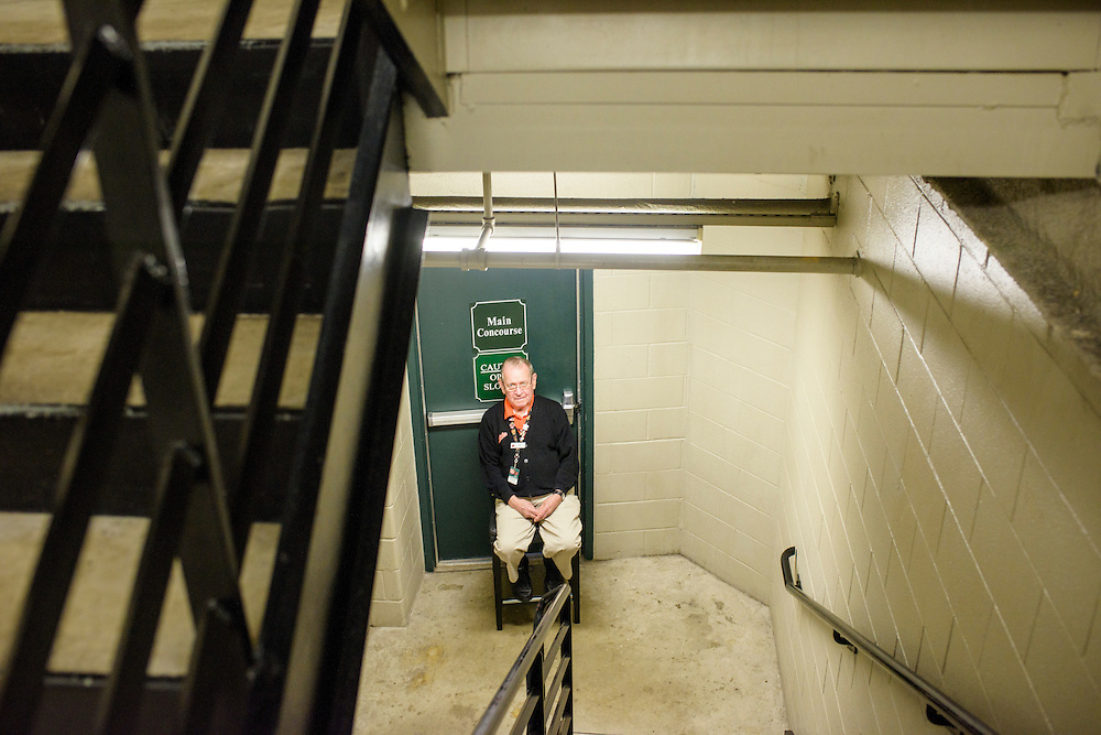 Baltimore, MD - April 29, 2015: Press Box Team Member John Lowensen is guarding the entrance to the Main Concourse. Normally Mr. Lowensen works in the Lower Press box at Oriole Park at Camden Yards on April 29, 2015. The civil unrest in Baltimore has forced the game between the Chicago White Sox and Baltimore Orioles to be closed to the public and moved to the afternoon. (Matt Roth for ESPN)