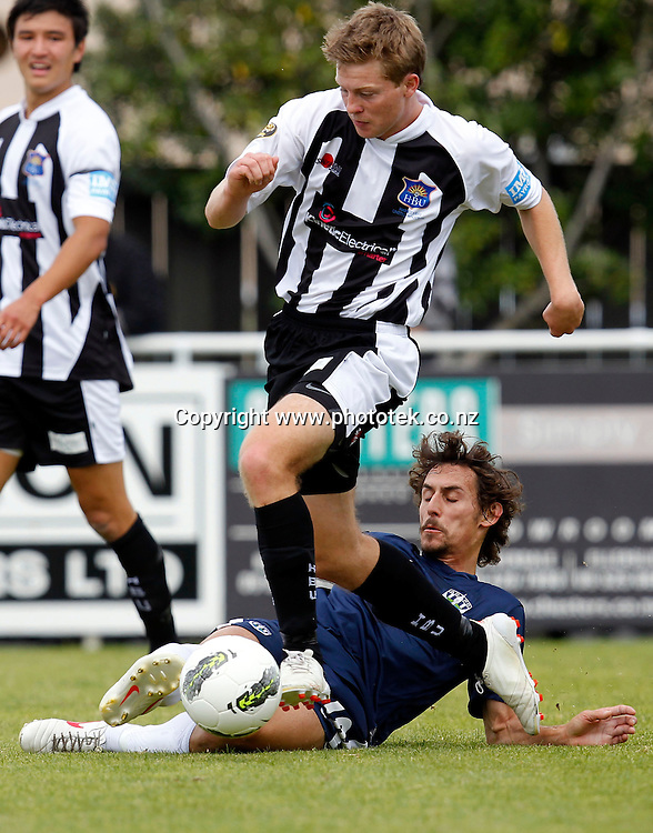 Auckland's Albert Riera tackles Bats Conor Tinnion. ASB Premiership, Round Three, Auckland City FC v Hawkes Bay United, Kiwitea Street Auckland, Sunday 18th November 2012. Photo: Shane Wenzlick