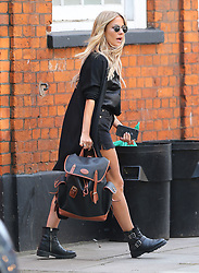 Love Island's presenter Caroline Flack looking sensational with her glowing tan. Caroline was all smiles as she steps out in London wearing a long black cardigan, silk blouse, black denim shorts and a pair of buckle boots... . UK. 20/08/2019<br /> BYLINE MUST READ : JAMESY/GOTCHA IMAGES<br /> <br /> Copyright by © Gotcha Images Ltd. All rights reserved.<br /> Usage of this image is conditional upon the acceptance <br /> of Gotcha Images Ltd, terms and conditions available at<br /> www.gotchaimages.com