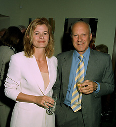 SIR NORMAN & LADY FOSTER, he is the architect at a party in London on 11th June 1997.LZG 61
