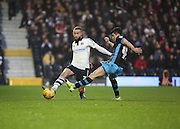 Fulham defender Ashley (Jazz) Richards battling with Sheffield Wednesday striker Fernando Forestieri during the Sky Bet Championship match between Fulham and Sheffield Wednesday at Craven Cottage, London, England on 2 January 2016. Photo by Matthew Redman.