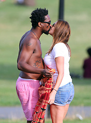 Lisa Snowdon and boyfriend Adereti Monney enjoying the sunshine at a north London park. The Radio DJ and the actor looked very much in love as they smooched and hugged each other. Lisa stripped down to a white vest top and denim shorts and exposed her underwear. London, UK. 03/08/2014<br />