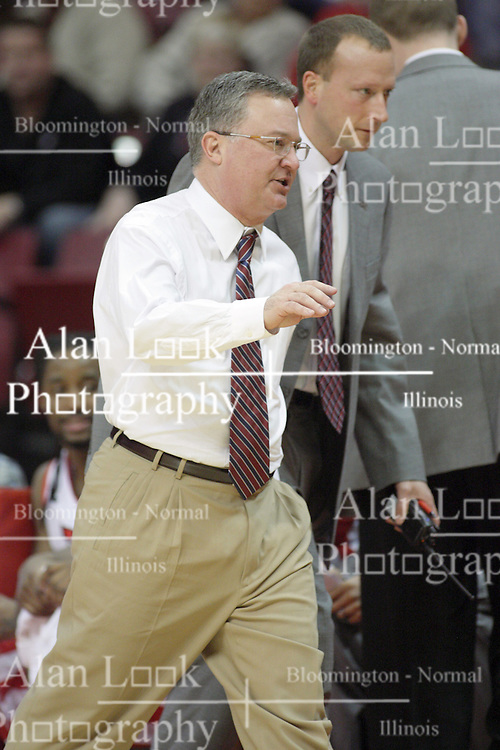 02 February 2013:  Barry Hinson gets escorted from the floor after the Salukis bench gets two technical fouls in a few seconds with less than a minute left to play during an NCAA Missouri Valley Conference mens basketball game where the Salukis of Southern Illinois lost to the Illinois State Redbirds for Retro-Night 83-47 in Redbird Arena, Normal IL
