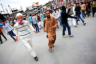 Muslim men take to the streets to protest the Indian general elections on May 8, 2009 in Srinagar in the state of Jammu Kashmir, India. At least 30 people were injured when Indian police in Kashmir's main city fired teargas shells to disperse thousands of Muslims protesting the general election. Separatists oppose the holding of elections in Kashmir, arguing that they will not resolve the future of the disputed territory, held in part by India and Pakistan but claimed in full by both. Turnout in the Kashmir valley, flashpoint of a two-decade-long insurgency, was as low as 19 percent .