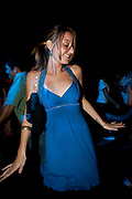 FEMALE CLUBBER IN BLUE DRESS SMILING
