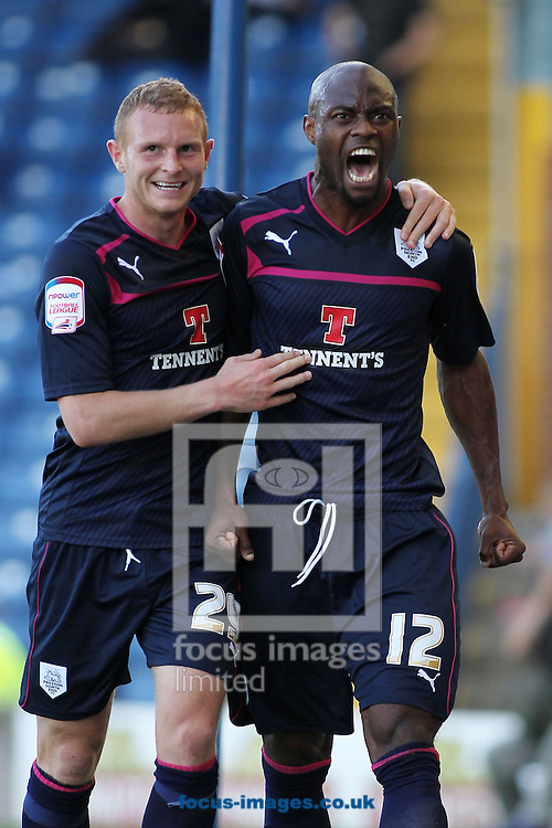 Picture by Michael Sedgwick/Focus Images Ltd +44 7900 363072.08/09/2012.Akpo Sodje of Preston North End celebrates with Stuart Beavon after scoring the first goal against Bury during the npower League 1 match at Gigg Lane, Bury.