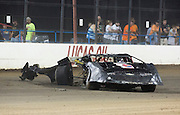 "Mark Penticuff sits in his Late-Model Camaro after being wrecked in the first lap of the ""B Feature"" race during NWTF race night at Lucas Oil Speedway on August 3, 2013 in Wheatland, Missouri. Penticuff snapped is axle tube and bent his right rear axle after another car collided into him during the race. (David Welker)"