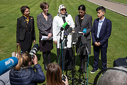 © Licensed to London News Pictures. 10/05/2018. London, UK. Fatima Boudchar (centre) addresses the media outside Parliament after Attorney General Jeremy Wright announced that a settlement had been reached over her 2004 rendition to Libya. Fatima Boudchar and her husband, Abdel Hakim Belhaj, were kidnapped in Thailand in 2004 and flown to Libya in a rendition operation, allegedly with the help of MI6. Photo credit: Rob Pinney/LNP