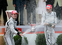 MONTE-CARLO, MONACO - Sunday, May 24, 2009: Jenson Button (GBR Brawn GP) (R) and Rubens Barrichello (BRA Brawn GP) celebrate their one-two podium finish during the Monaco Formula One Grand Prix at the Monte-Carlo Circuit. (Pic by Juergen Tap/Hoch Zwei/Propaganda)