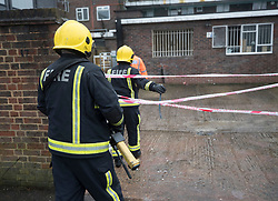 © Licensed to London News Pictures. 04/03/2018. Harold Hill, UK. Firefighters enter the back yard of Harold Hill Post Office where emergency services are currently responding to reports of an explosion. Nearby homes have been evacuated. Photo credit: Peter Macdiarmid/LNP