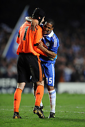 Florent Malouda celebrates with team mate Petr Cech of Chelsea during the UEFA Champions League Quarter Final Second Leg match between Chelsea and Liverpool at Stamford Bridge on April 14, 2009 in London, England.