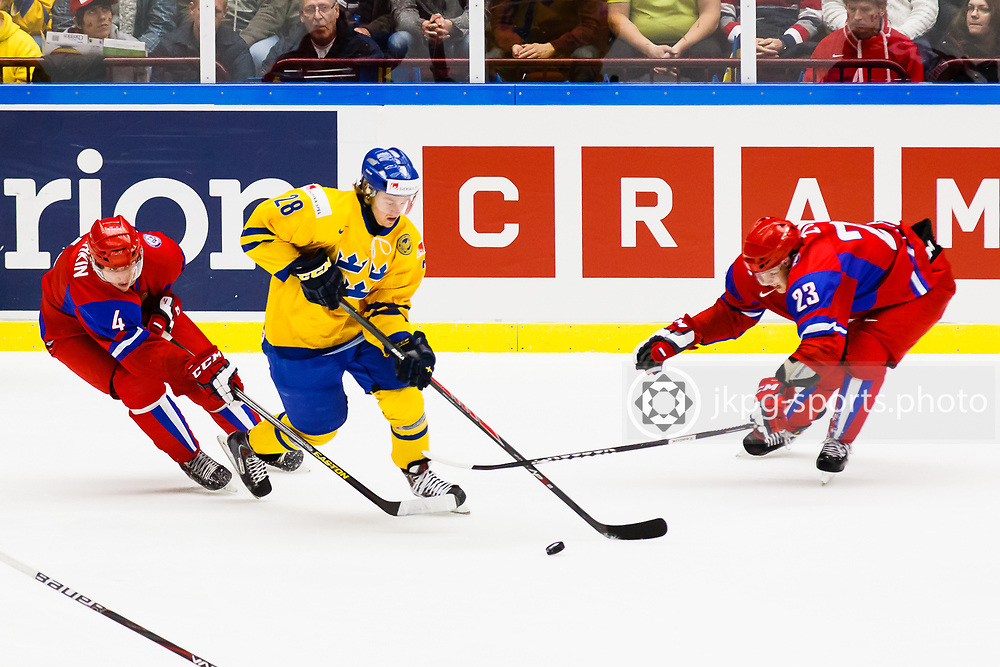140104 Ishockey, JVM, Semifinal,  Sverige - Ryssland<br /> Icehockey, Junior World Cup, SF, Sweden - Russia.<br /> Ilya Lyubushkin, (RUS), Lucas Wallmark, (SWE), Valentin Zykov, (RUS).<br /> Endast f&ouml;r redaktionellt bruk.<br /> Editorial use only.<br /> &copy; Daniel Malmberg/Jkpg sports photo