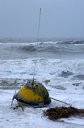 GERMANY SCHLESWIG-HOLSTEIN SYLT 1FEB13 - A wave measuring buoy from the Dutch Rijkswaterstraat department lies abandoned in the surf on the beach near Hoernum on the north frisian island of Sylt, North Sea, Germany.....jre/Photo by Jiri Rezac....© Jiri Rezac 2013