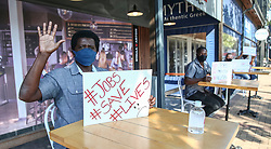 South Africa - Durban -  22 July 2020 -   Between 12pm and 2pm, a number of restaurant owners, managers and staff took to the streets near their restaurants, protesting that the last few months have taken a financial toll on the industry and would continue to do so unless some of the Covid-19 regulations are lifted. Picture Leon Lestrade/African News Agency(ANA).