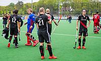 BLOEMENDAAL -  Teleurstelling bij oa Niek Merkus (Adam) , na  Hoofdklasse hockey Bloemendaal-Amsterdam (4-2) . COPYRIGHT KOEN SUYK