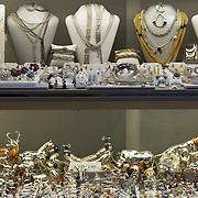 Italy, Veneto, Venice. November/12/2007...Silver jewelry storefront window in Venice, Italy...