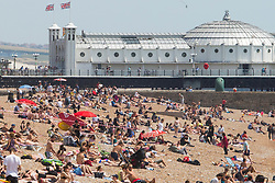 © Licensed to London News Pictures. 07/07/2017. Brighton, UK. Members of the public take advantage of the sunny weather to relax and sunbath on the beach in Brighton and Hove Photo credit: Hugo Michiels/LNP
