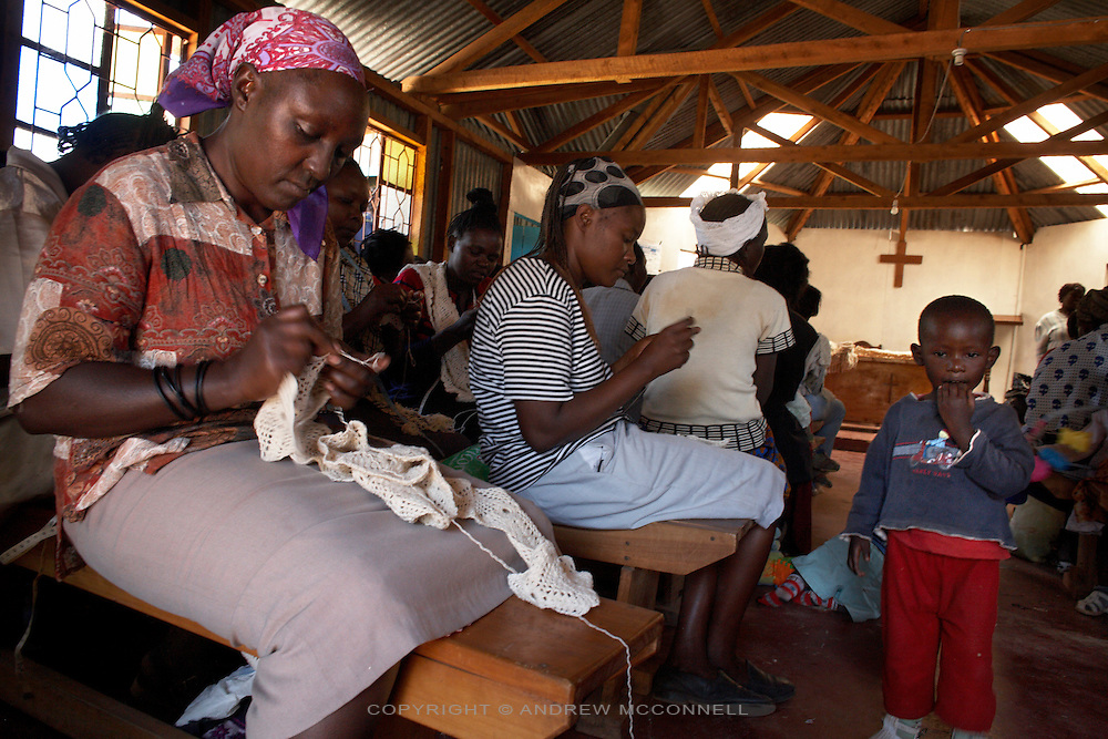 """The Totoknits group create handmade crochet items from their base at Karinde Anglican Church, in the Dagoretti area of Nairobi, Kenya, in Monday, Jan. 12, 2009. The Totoknits group consists of 150 women who produce some of the crochet hand-bags, cases and scarfs for MAX&Co. The products are part of the company's """"ethical fashion"""" range in Africa which is designed to reduce extreme poverty and empower women. The limited edition collection consists of one-of-a-kind handmade accessories such as shoulder-bags, bracelets, key-rings, belts and scarfs."""