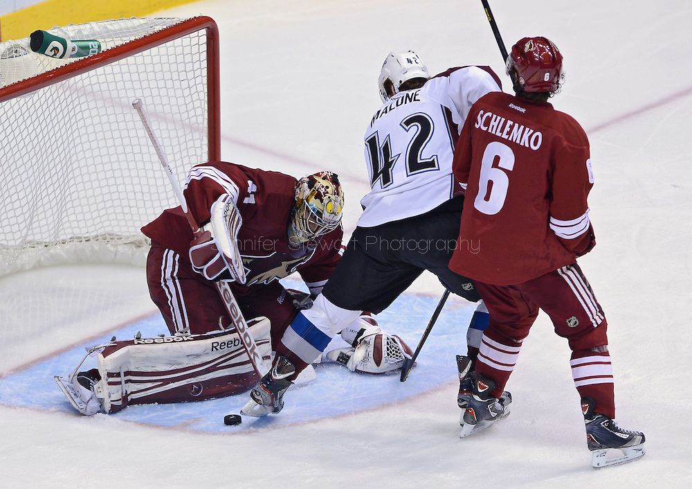 Apr. 6, 2013; Glendale, AZ, USA;  Phoenix Coyotes goalie Mike Smith (41) blocks the puck from Colorado Avalanche center Brad Malone (42) in the third period at Jobing.com Arena. The Coyotes defeated the Avalanche 4-0.  Mandatory Credit: Jennifer Stewart-USA TODAY Sports