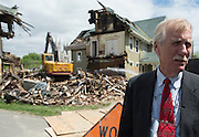 Sen. Angus King speaks the members of the media at the site of the April 29 fire on Pine Street in Lewiston, Maine on May 17, 2013. The fire was the first of three arsons in one week within three blocks of each other in downtown Lewiston.