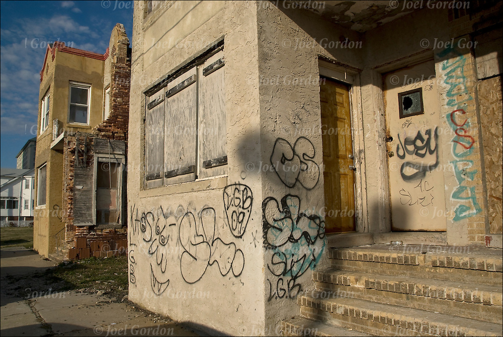 Abandoned and boarded up building with tag graffitti in a high drug and crime area in Atlantic City, New Jersy
