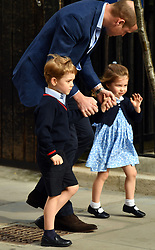 The Duke of Cambridge with his son Prince George and his daughter Princess Charlotte as they arrive to meet his newborn son at the Lindo Wing at St Mary's Hospital in Paddington, London.