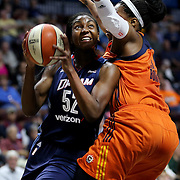 UNCASVILLE, CONNECTICUT- JUNE 3:   Elizabeth Williams #52 of the Atlanta Dream drive to the basket defended by Kelsey Bone #3 of the Connecticut Sun during the Atlanta Dream Vs Connecticut Sun, WNBA regular season game at Mohegan Sun Arena on June 3, 2016 in Uncasville, Connecticut. (Photo by Tim Clayton/Corbis via Getty Images)