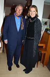 SIR TERENCE & LADY CONRAN at a party to celebrate a book of work by artist Jack Vettriano held at The Bluebird Club & Dining Room, 350 Kings Road, London on 7th December 2004.<br />