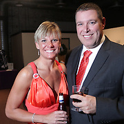 Jennifer Glover, left, and Eric Burgos pose for a picture during the Diamonds and Champagne Hope Ball Saturday November 22, 2014 at the Coastline Convention Center in Wilmington, N.C. (Jason A. Frizzelle)