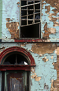 Peeling walls plus broken windows and doors on a derelict property in the Toxteth area of Liverpool, on 8th August 1991, in Liverpool, Merseyside, England.