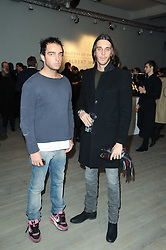 Left to right, ANDY VALMORBIDA and VLADIMIR RESTOIN ROITFELD at a private view of Masters of Photography - A Journey presented by Macallan and Albert Watson held at Philips De Pury, Howick Place, London SW1 on 1st December 2010.