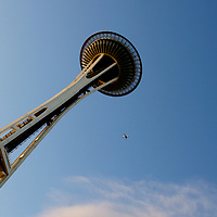 A plane flies near the Space Needle in Seattle, Washington..Melanie Maxwell