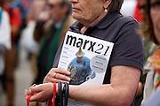 Frankfurt am Main | 30 Aug 2014<br /> <br /> Am Samstag (30.08.2014) demonstrierten &uuml;ber 200 Aktivisten aus dem Umfeld der Partei &quot;Die Linke&quot; und anderen linken und linksradikalen Zusammenh&auml;ngen gegen Krieg und f&uuml;r Frieden. Einige ukrainische Nationalisten und Aktivisten der dubiosen Montagsmahnwache in Frankfurt hatten sich unter die Friedensdemonstranten gemischt.<br /> Hier: Eine Aktivistin in der Demo mit einer Zeitschrift mit dem Titel &quot;Marx 21&quot;.<br /> <br /> &copy;peter-juelich.com<br /> <br /> [No Model Release | No Property Release]
