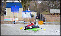 Residents of Egham, United Kingdom, struggle through the floods as it starts to rise in the town, Wednesday, 12th February 2014. Picture by Andrew Parsons / i-Images