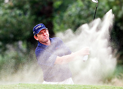 Zimbabwe's Nick Price plays the ball from a bunker during a practice round for the 130th Open Championship at Royal Lytham St Annes.