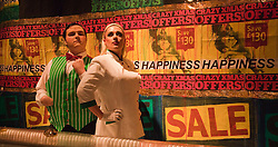 """© Licensed to London News Pictures. 14/12/2011. London, UK. Performers: Ryan Styles and Tim Hopkins. Theatre collective """"Duckie"""" returns to the Barbican for their """"Copyright Christmas"""" promenade performance show (10 to 31 December 2011). With capitalism collapsing and the criminal economy taking over, there has never been a better time to go shopping to witness the decaying arcades of branded Britain. Photo credit: Bettina Strenske/LNP"""