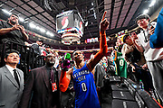 PORTLAND, OREGON - MARCH 07:  At the end of the game against the Portland Trail Blazers, Russell Westbrook #0 of the Oklahoma City Thunder tosses a shoe to a fan at the Moda Center on March 07, 2019 in Portland, Oregon. The Oklahoma City Thunder won in overtime 129-121. NOTE TO USER: User expressly acknowledges and agrees that, by downloading and or using this photograph, User is consenting to the terms and conditions of the Getty Images License Agreement. (Photo by Alika Jenner/Getty Images)