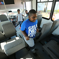 Jamarcus Shaw, 7, of Tupelo, boards the bus of the Boys & Girls Club new 24 passenger bus that was purchased with a grant received last year from the ER Carpenter Foundation. The group made a small field trip to the Carpenter Company to thank them for the donation.