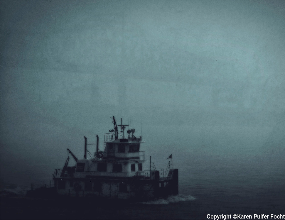 A tug boat pushes through a heavy rainstorm in The Port of Greater Baton Rouge as it pushes up the Mississippi River. Cruisers get a close up look at life on the river from the decks of the boat and in some cases just outside their room.