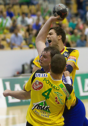 Matic Vrecar of Trimo between Vid Poteko and Carlos Martos Prieto of Celje during handball match between RK Celje Pivovarna Lasko and Trimo Trebnje of last Round of 1st Slovenian Handball league, on May 27, 2011 in Arena Zlatorog, Celje, Slovenia. Celje defeated Trimo 32-28 and win 3rd place in Slovenian National Championship. (Photo By Vid Ponikvar / Sportida.com)