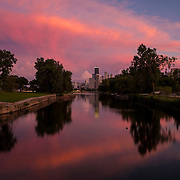 A colorful summer sunset is reflected in Diversey Harbor in front of the John Hancock Center and the Chicago skyline Saturday, Aug. 30, 2014. (Brian Cassella/Chicago Tribune) B583978571Z.1 <br /> ....OUTSIDE TRIBUNE CO.- NO MAGS,  NO SALES, NO INTERNET, NO TV, CHICAGO OUT, NO DIGITAL MANIPULATION...