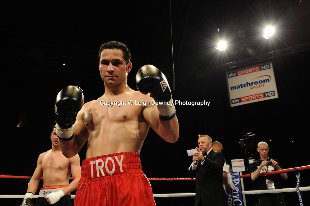 Troy James (red shorts) defeats Fouad El Bahji on the 9th April 2010 at Alexandra Palace, London. Matchroom Sport. Photo credit: © Leigh Dawney